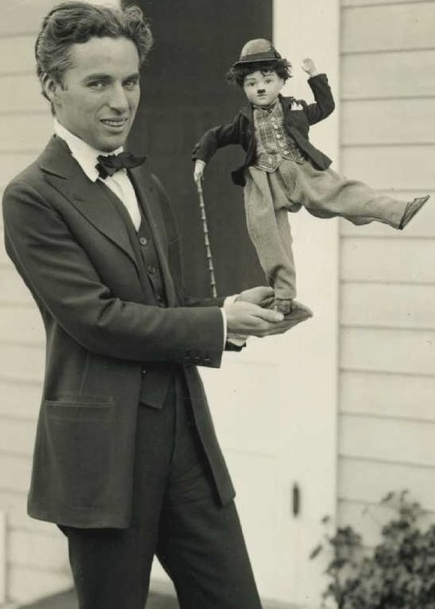 Charlie_Chaplin_with_doll